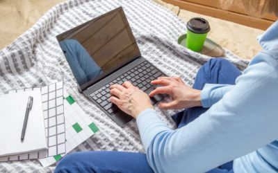 Women working from bed with computer